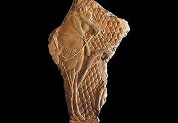 Relieve asirio con un palafrenero y su caballo